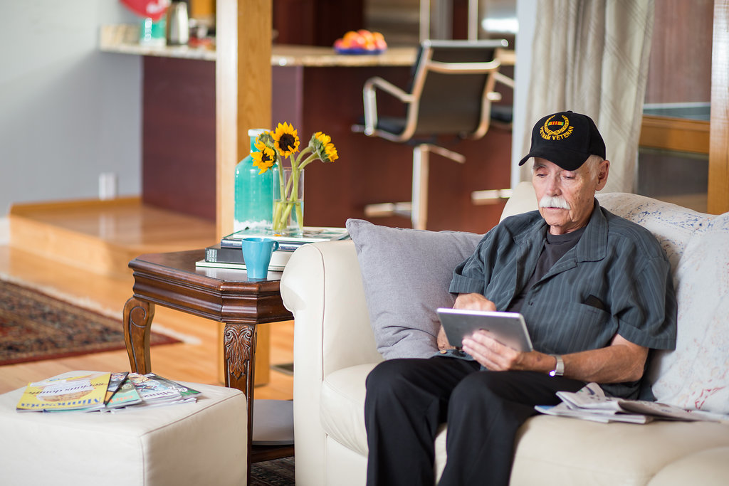 Veteran using tablet at home.